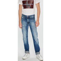 Calvin Klein Jeans - Jeansy CKJ 026. Niebieskie jeansy męskie slim Calvin Klein Jeans, z bawełny. Za 539,90 zł.