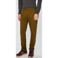 U.S. Polo - Spodnie. Brązowe rurki męskie marki U.S. Polo, z bawełny. W wyprzedaży za 359,90 zł.