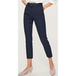 Spodnie z wysokim stanem - Granatowy. Niebieskie spodnie z wysokim stanem Reserved. Za 89,99 zł.
