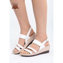 Białe Skórzane Sandały Own Self. Białe sandały damskie marki Born2be, z materiału, na koturnie. Za 99,99 zł.