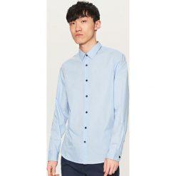 Koszula we wzory - Niebieski. Niebieskie koszule męskie Reserved, m. Za 79,99 zł.