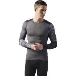 KOSZULA REEBOK AC GRAPHIC LS COMP  DGREYH. Szare koszule męskie na spinki Reebok, m, moro, z materiału, z długim rękawem. Za 139,99 zł.