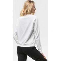 Cardio Bunny - Bluza Poppy. Czarne bluzy sportowe damskie marki DOMYOS, z elastanu. W wyprzedaży za 99,90 zł.
