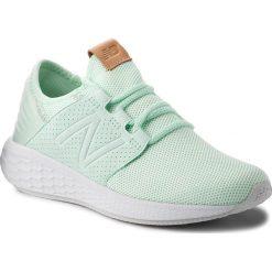 Buty NEW BALANCE - WCRUZKM2 Zielony. Zielone buty do biegania damskie marki New Balance, z materiału. W wyprzedaży za 269,00 zł.