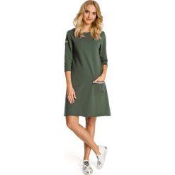 Khaki Sukienka Trapezowa Dzianinowa z Ozdobnymi Tasiemkami. Zielone sukienki dresowe marki Reserved. Za 115,90 zł.