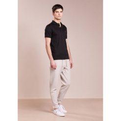 Polo Ralph Lauren Spodnie treningowe grey. Szare spodnie dresowe męskie Polo Ralph Lauren, z bawełny. Za 459,00 zł.