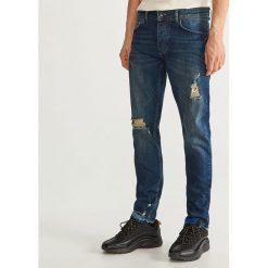 Jeansy slim fit z przetarciami - Niebieski. Niebieskie jeansy męskie relaxed fit marki QUECHUA, m, z elastanu. Za 149,99 zł.