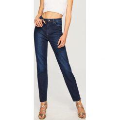 Jeansy z wysokim stanem - Granatowy. Niebieskie spodnie z wysokim stanem marki Reserved, z jeansu. Za 119,99 zł.
