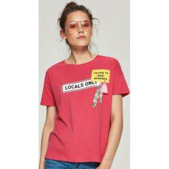 T-shirty damskie: T-shirt z aplikacją – Pomarańczo