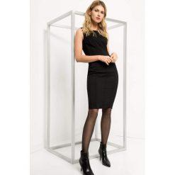 Dopasowana sukienka ze szwami. Brązowe sukienki na komunię marki Orsay, s, z dzianiny. Za 119,99 zł.