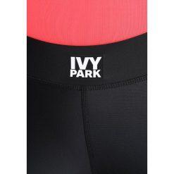 Ivy Park PANEL Legginsy black. Czarne legginsy marki Strategia. Za 439,00 zł.