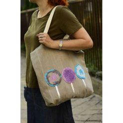 Torba na zakupy kółka. Brązowe shopper bag damskie Pakamera, z aplikacjami, z bawełny, z aplikacjami. Za 67,00 zł.