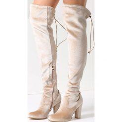 Beżowe Kozaki Likable. Brązowe buty zimowe damskie marki Kazar, ze skóry, przed kolano, na wysokim obcasie. Za 89,99 zł.