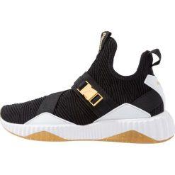 Puma DEFY MID VARSITY Obuwie treningowe black/metallic gold. Czarne buty sportowe damskie marki Puma, z materiału. Za 459,00 zł.