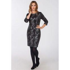 Sukienki: Sukienki z wężowym motywem