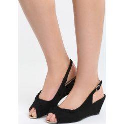 Czarne Sandały Going Out Tonight. Czarne sandały damskie marki bonprix, w paski, na koturnie. Za 69,99 zł.