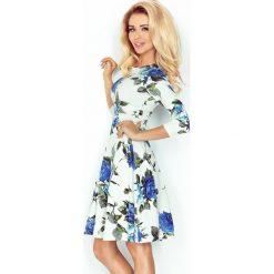 Paulina Rozkloszowana sukienka z rękawkiem. Niebieskie sukienki na komunię numoco, s, w kwiaty, rozkloszowane. Za 129,99 zł.