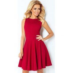 125-1 sukienka koło - dekolt łódka - cegiełka - bordowa. Czerwone sukienki numoco, l, z dekoltem w łódkę, oversize. Za 144,00 zł.