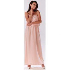 Pudrowa Maxi Sukienka z Odkrytymi Ramionami. Różowe długie sukienki marki numoco, l, z dekoltem w łódkę, oversize. Za 129,90 zł.
