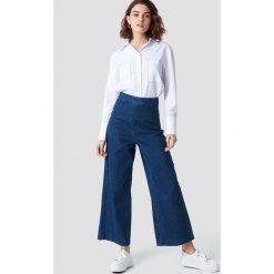 Spodnie damskie: NA-KD Szerokie spodnie z denimu - Blue