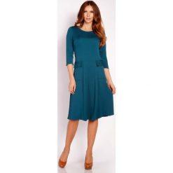 Zielona Sukienka Midi z Kieszeniami. Zielone sukienki balowe marki Molly.pl, l, z dzianiny, midi, rozkloszowane. Za 129,00 zł.