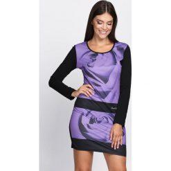 Fioletowa Sukienka Black Flower. Fioletowe sukienki dzianinowe marki DOMYOS, l. Za 44,99 zł.