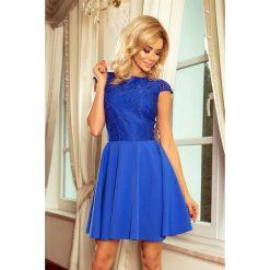 Sukienka MARIA z koronką - CHABROWA. Niebieskie sukienki koronkowe marki numoco, s, w koronkowe wzory, rozkloszowane. Za 189,99 zł.