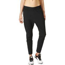 Adidas Spodnie damskie Z.N.E. Woven Pant  czarny r. L (S94577). Czarne spodnie sportowe damskie marki Adidas, l. Za 204,75 zł.