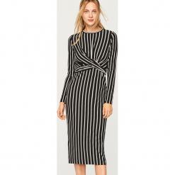 Sukienka midi w paski - Czarny. Czarne sukienki marki Reserved, l, w paski, midi. Za 59,99 zł.