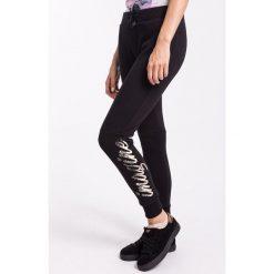 Spodnie dresowe damskie: Spodnie dresowe damskie SPDD005Z – czarny