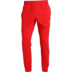 Spodnie dresowe męskie: adidas Originals ADICOLOR SST Spodnie treningowe scarle