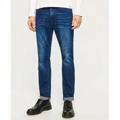 Jeansy slim fit - Granatowy. Niebieskie jeansy męskie relaxed fit marki QUECHUA, m, z elastanu. Za 169,99 zł.