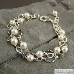Białe perełki I - bransoletka. Białe bransoletki damskie na nogę marki Pakamera. Za 144,00 zł.