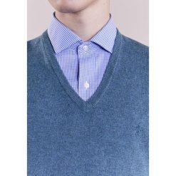 Polo Ralph Lauren LORYELLE Sweter supply blue heath. Niebieskie swetry klasyczne męskie marki Polo Ralph Lauren, m, z materiału, polo. W wyprzedaży za 345,95 zł.