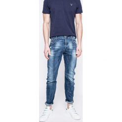 G-Star Raw - Jeansy. Niebieskie jeansy męskie slim G-Star RAW. W wyprzedaży za 399,90 zł.