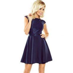 Sukienka MARIA z koronką - GRANATOWA. Niebieskie sukienki koronkowe marki numoco, s, w koronkowe wzory, rozkloszowane. Za 189,99 zł.