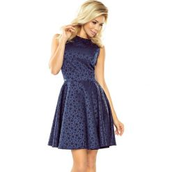 Sukienka żakardowa kółeczka sf-125-22. Niebieskie sukienki koktajlowe marki SaF, na co dzień, xl, z żakardem, z asymetrycznym kołnierzem, dopasowane. W wyprzedaży za 149,00 zł.