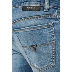 Guess Jeans - Jeansy Angels. Szare jeansy męskie skinny marki Guess Jeans, l, z aplikacjami, z bawełny. W wyprzedaży za 269,90 zł.