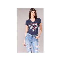 T-shirty z krótkim rękawem Guess  FENALIE. Niebieskie t-shirty damskie marki Guess, l, z aplikacjami. Za 129,00 zł.