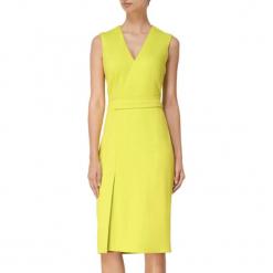 Sukienka w kolorze limonkowym. Żółte sukienki z falbanami marki BOHOBOCO, midi. W wyprzedaży za 909,95 zł.