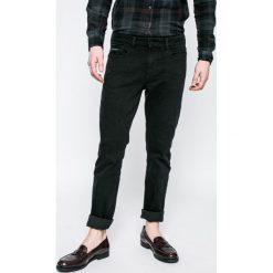 Calvin Klein Jeans - Jeansy. Czarne jeansy męskie slim marki Calvin Klein Jeans, z aplikacjami, z bawełny. W wyprzedaży za 239,90 zł.