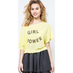 Bluzka z szerokim dekoltem Girl Power żółta. Żółte bluzki dziewczęce bawełniane Yups, z nadrukiem, z krótkim rękawem. Za 12,00 zł.