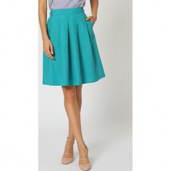 Spódnica w kolorze turkusowym. Niebieskie spódniczki rozkloszowane TrakaBarraka, l, w paski, midi. W wyprzedaży za 119,95 zł.