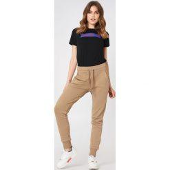 NA-KD Basic Spodnie dresowe basic - Beige. Różowe spodnie z wysokim stanem marki NA-KD Basic, z bawełny. Za 100,95 zł.