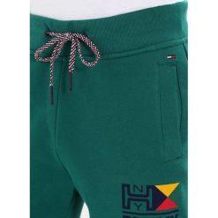 Spodnie dresowe męskie: Tommy Jeans RETRO Spodnie treningowe evergreen