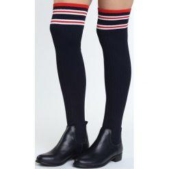Granatowe Kozaki Verity. Czarne buty zimowe damskie marki Born2be, na płaskiej podeszwie. Za 119,99 zł.