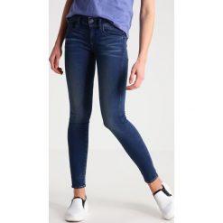 GStar LYNN MID SKINNY Jeans Skinny Fit darkblue denim. Niebieskie jeansy damskie marki G-Star, z bawełny. W wyprzedaży za 390,15 zł.