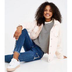 Jeansy skinny ze zdobieniami. Szare jeansy damskie marki Pull & Bear, okrągłe. Za 139,00 zł.