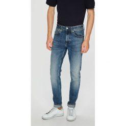 Calvin Klein Jeans - Jeansy. Niebieskie jeansy męskie skinny marki Calvin Klein Jeans, z aplikacjami, z bawełny. Za 399,90 zł.