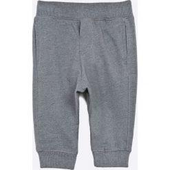 Blukids - Spodnie dziecięce 68-98 cm. Szare spodnie chłopięce Blukids, z nadrukiem, z bawełny. W wyprzedaży za 29,90 zł.